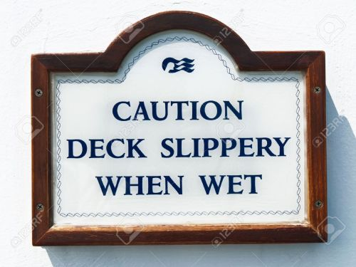 13727196-sign-for-slippery-deck-on-the-cruise-boat-Stock-Photo
